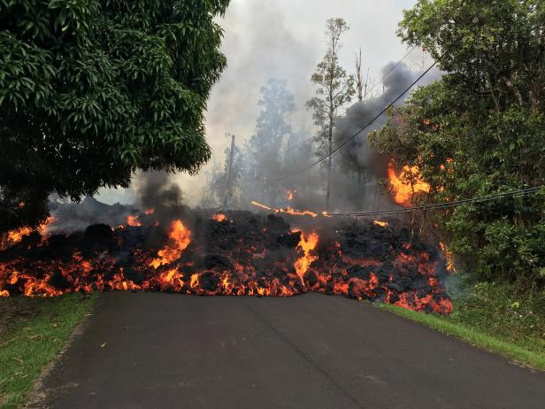 A lava flow from the Kilauea volcano, moves on a street in Leilani Estates in Hawaii