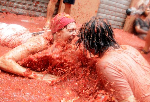 Revellers play in tomato pulp during the annual Tomatina festival in Bunol near Valencia