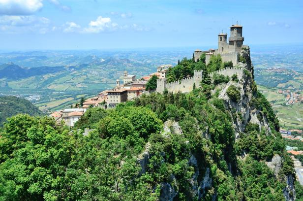 A castle covered in greenery in San Marino