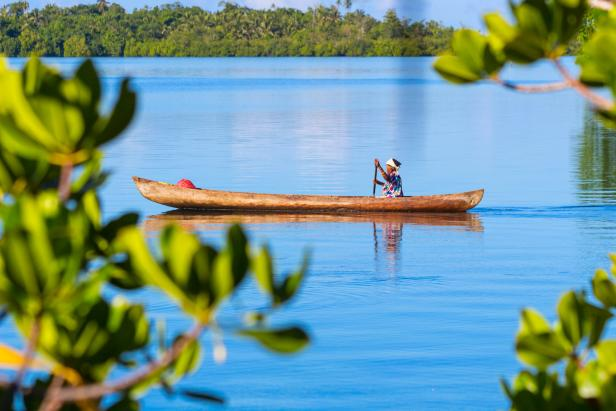Woman Canoeing at Langa Langa Lagoon Solomon Islands