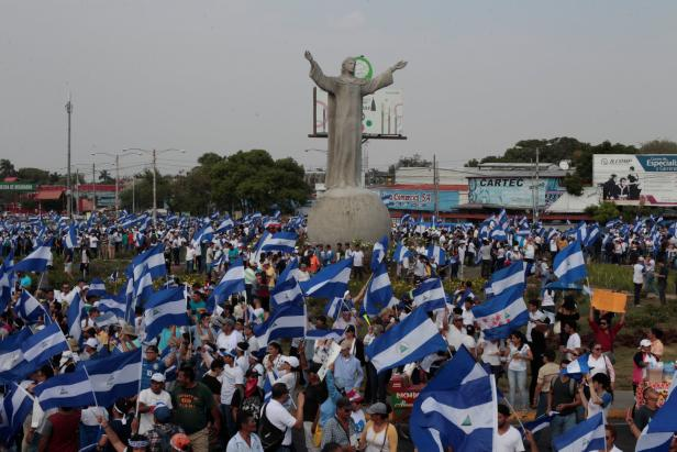 Demonstrators take part in a protest march against Nicaraguan President Daniel Ortega's government in Managua