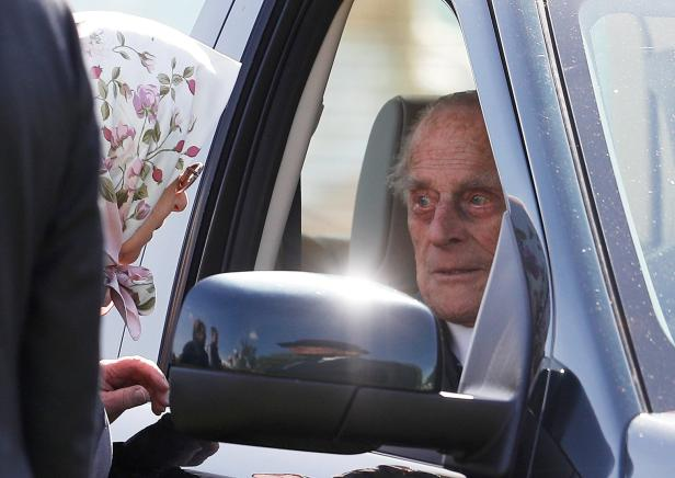 Britain's Queen Elizabeth speaks to Prince Philip at the Royal Windsor Horse Show, in Windsor