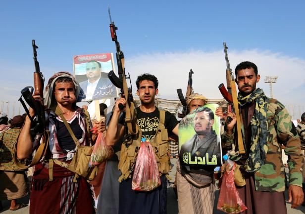 Houthi supporters hold up rifles as they rally to protest the killing of Saleh al-Samad, a senior Houthi official, by a Saudi-led coalition air strike in Hodeidah