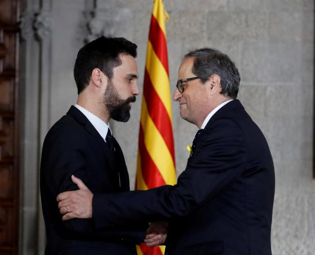 Quim Torra is greeted by regional parliament speaker Roger Torrent after taking his oath as new Catalan Regional President during a ceremony at Generalitat Palace in Barcelona
