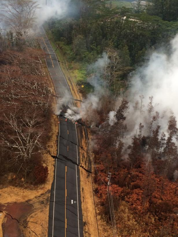 Aerial view of ground cracks on a road during an overflight of the eruptrive fissure area following eruption of Kilauea volcano, Hawaii