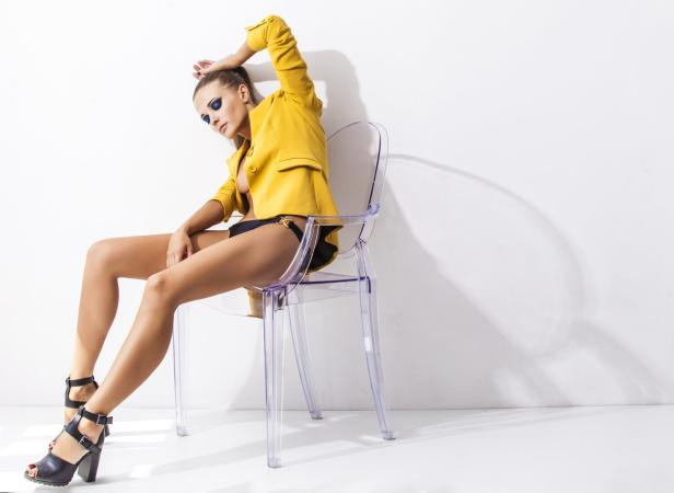 Full-length portrait young elegant woman in the yellow jacket