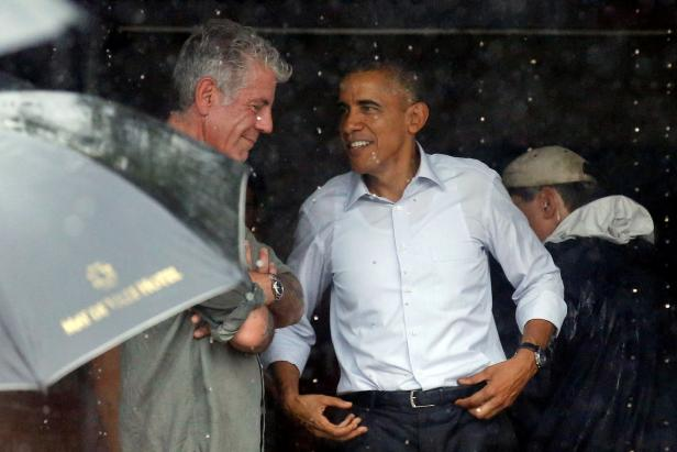 U.S. President Barack Obama talks with Anthony Bourdain after an interview at a shopping area of Hanoi, Vietnam