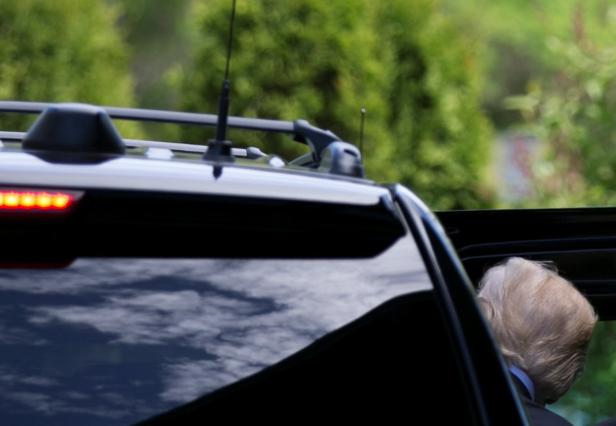 Trump gets into his vehicle as he leaves the G7 Summit in the Charlevoix town of La Malbaie, Quebec