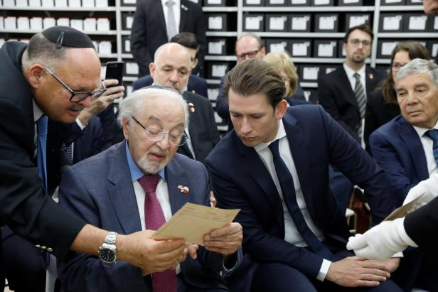 Austrian Chancellor Sebastian Kurz sits next to Austrian Holocaust survivor Viktor Klein during a tour of the archives of the Holocaust History Museum at Yad Vashem World Holocaust Remembrance Center in Jerusalem