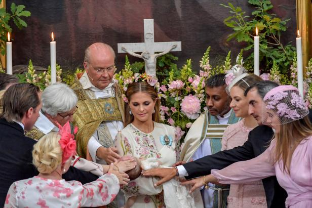 Princess Madeleine with Princess Adrienne are seen together during the christening ceremony  in Drottningholm Palace Chapel outside Stockholm