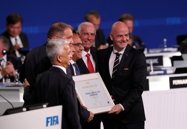 FIFA President Gianni Infantino poses for a picture with officials after the announcement, that the 2026 FIFA World Cup will be held in the United States, Mexico and Canada, during the 68th FIFA Congress in Moscow