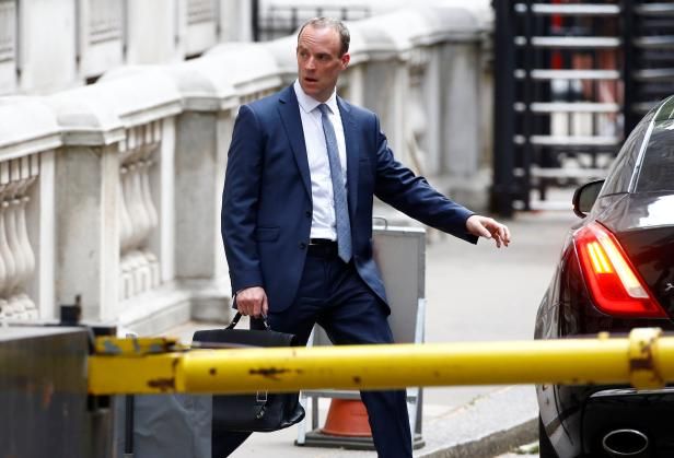 Britain's newly appointed Secretary of State for Exiting the European Union Dominic Raab leaves Downing Street in Westminster, London