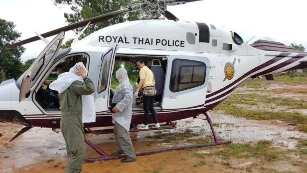 Rescue personnel prepare the transport for the evacuation of the boys and their soccer coach trapped in a flooded cave, in the northern province of Chiang Rai