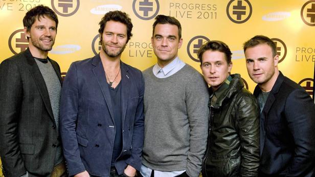 Tätscheln & Hätscheln: Seit 2008 sind die Erzfeinde Robbie Williams (li.) und Gary Barlow beste Freunde.