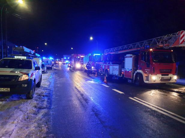 Fire trucks seen at site of building levelled by gas explosion in Szczyrk