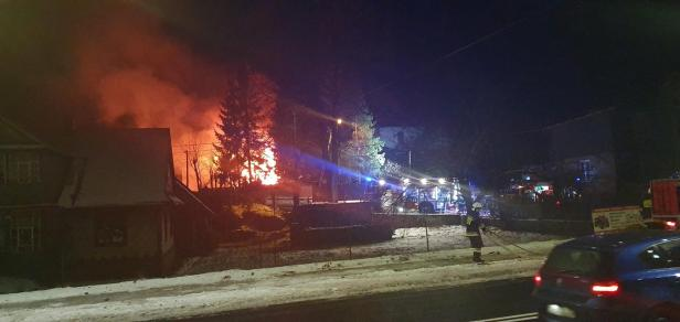 First responders work near the site of a gas explosion that levelled a building in Szczyrk