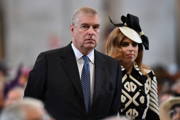 FILE PHOTO: Britain's Prince Andrew, and Princess Beatrice arrive for a service of thanksgiving for Queen Elizabeth's 90th birthday at St Paul's Cathedral in London