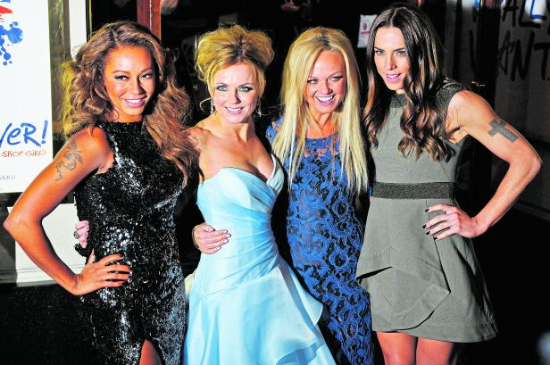 """FILE PHOTO: Spice Girls members arrive for the premiere of the musical """"Viva Forever!"""", based on the music of the Spice Girls, in central London"""