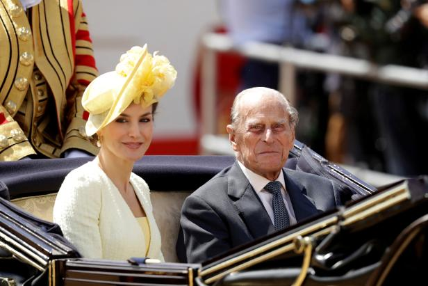 FILE PHOTO: Britain's Prince Philip rides in a carriage with Spain's Queen Letizia, following a ceremonial welcome on Horseguards Parade, in central London