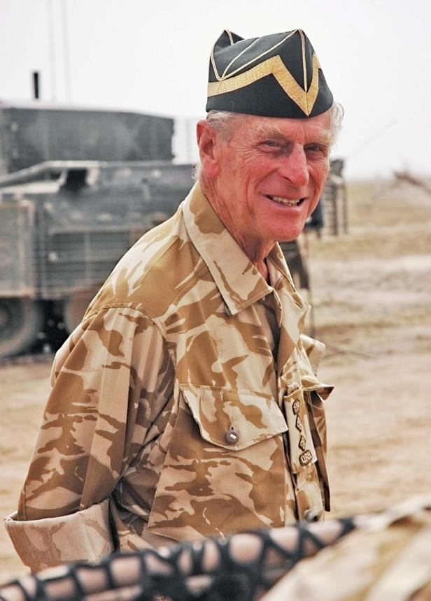 FILE PHOTO: Britain's Duke of Edinburgh, Prince Philip is seen visiting The Queen's Royal Hussars in Basra in this handout photograph