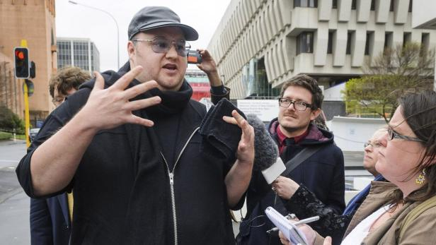 Megaupload founder Dotcom talks to members of the