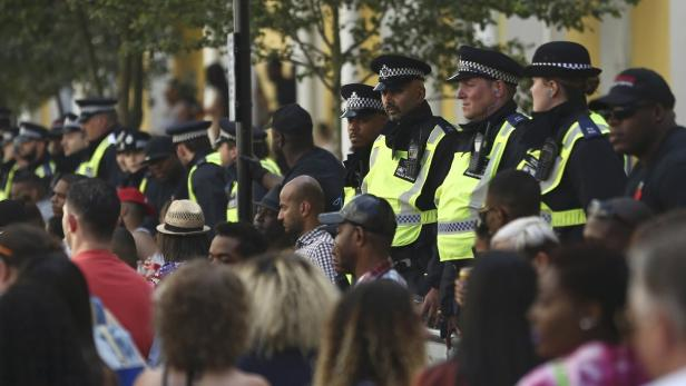 Police keep watch at the Notting Hill Carnival in