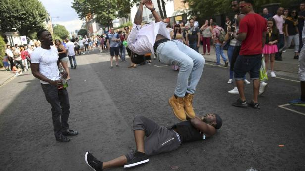 People dance during the Notting Hill Carnival in L