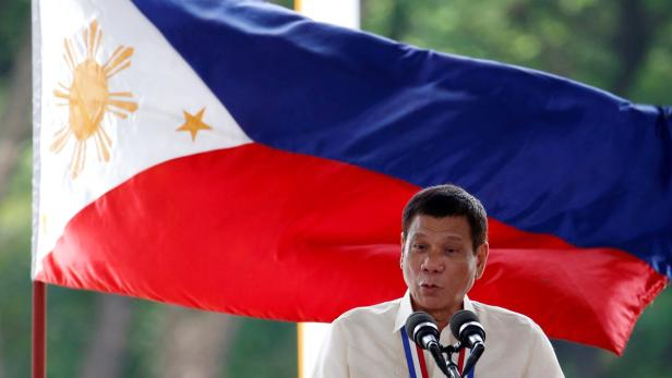Philippine President Duterte speaks in front of a