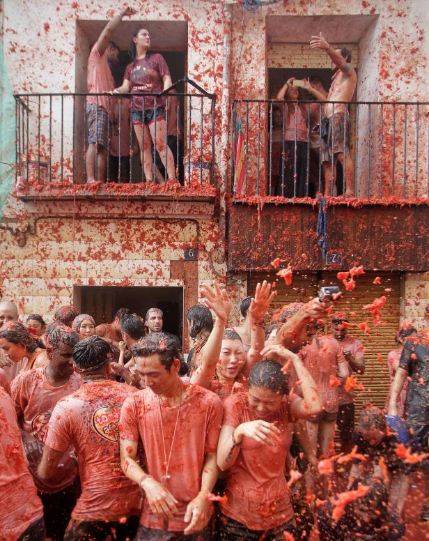 Revellers battle with tomato pulp during the annua