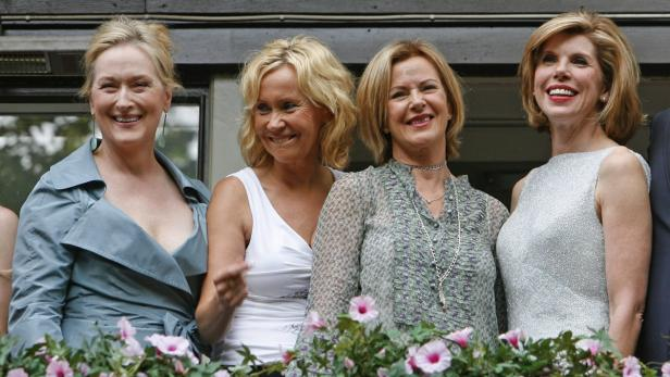 Abba members Faltskog and Lyngstad pose with cast