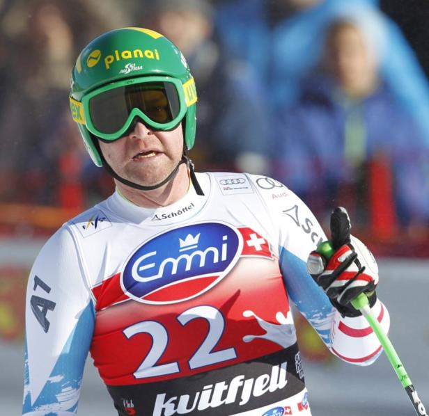 Kroell of Austria reacts at the finish of the Alpi