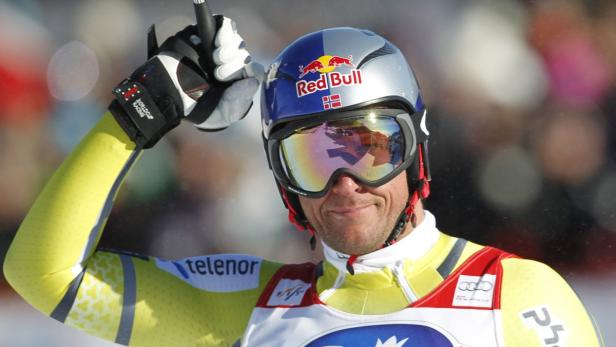 Svindal of Norway reacts at the finish of the Alpi