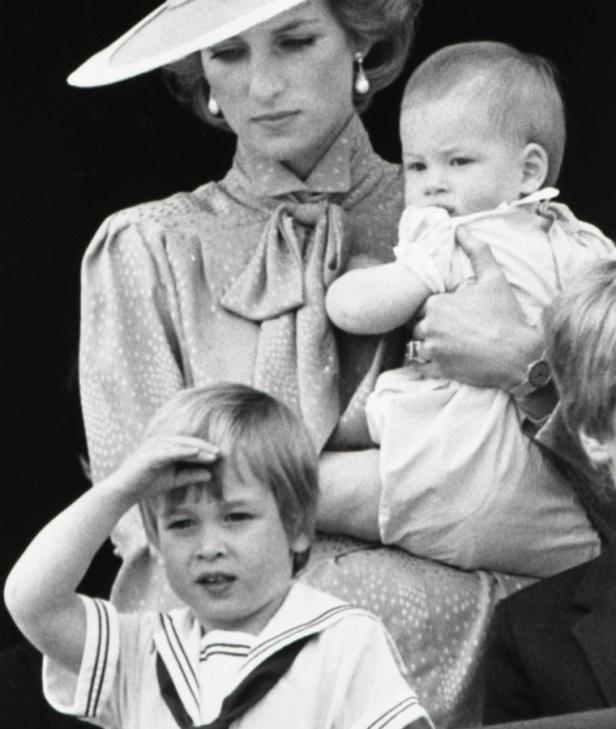 ReutersPrince William is seen making a royal salute as he watches the scene of Trooping the Colour from the balcony of Buckingham Palace with his brother Harry and mother Princess Diana in London in this June 15, 1985 file photograph. Britains Prince Will
