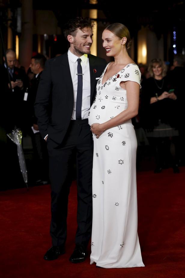 Actor Sam Claflin and partner Laura Haddock pose f