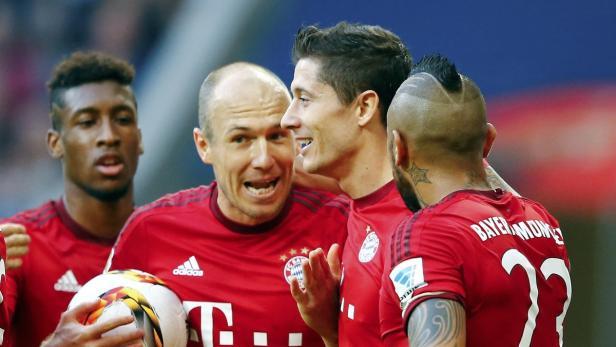 Munich players celebrate a goal against VfB Stuttg