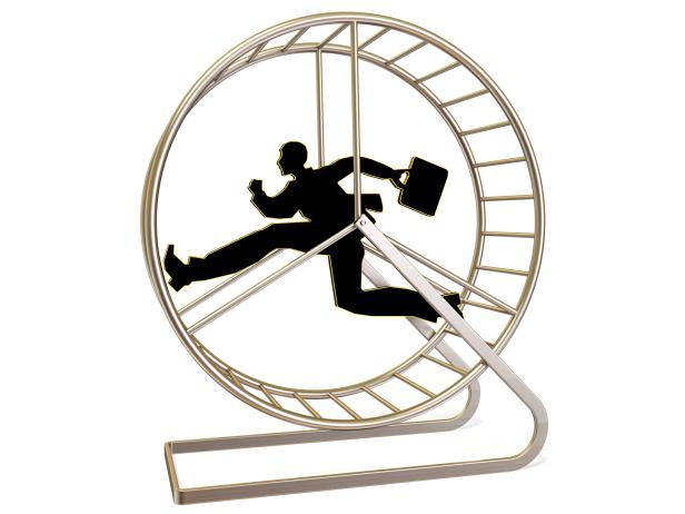 man  running in exercise wheel  on white backgroun…