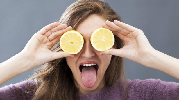 funny beautiful girl with lemons on eyes for fun vision