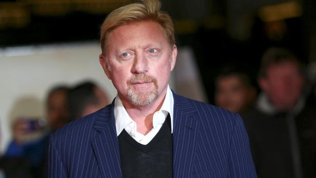 """FILE PHOTO: Former tennis player Boris Becker poses for photographers at the world premiere of the film """"I am Bolt"""" in London"""