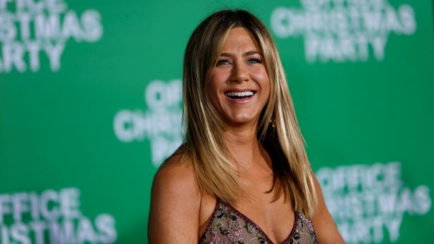 """FILE PHOTO - Jennifer Aniston poses at the premiere of """"Office Christmas Party"""" in Los Angeles"""