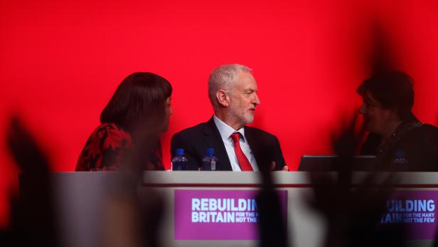 Delegates vote on the Labour Party's Brexit policy as party leader Jeremy Corbyn, Shadow Foreign Secretarty Emily Thornberry and Diane Abbott, the Shadow Home Secretary sit on the podium at the party's conference in Liverpool