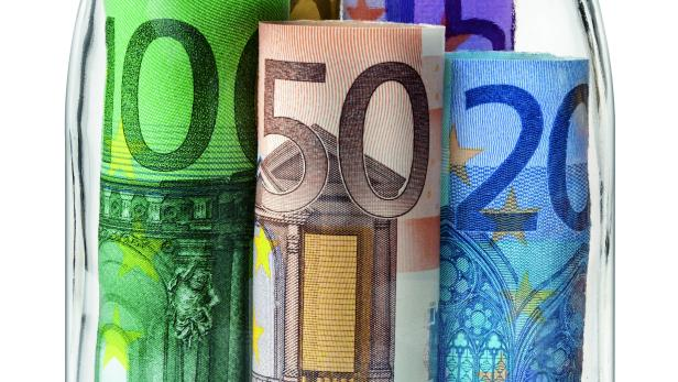 Money. Euro banknotes in a glass jar.