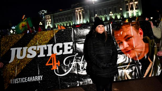 FILE PHOTO: Harry Dunn's mother Charlotte Charles poses in front of a banner outside the Buckingham Palace