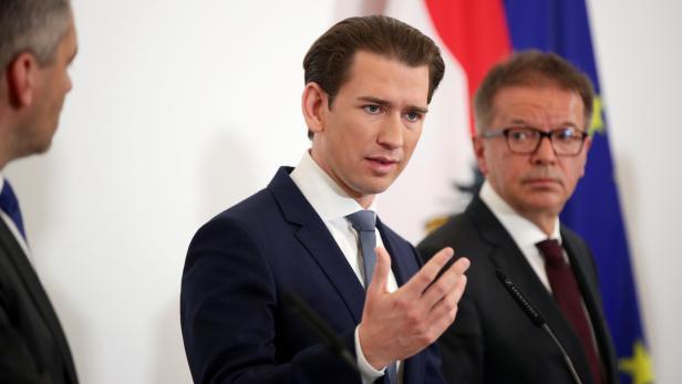 Austrian Chancellor Sebastian Kurz and Health Minister Rudolf Anschober attend a news conference in Vienna