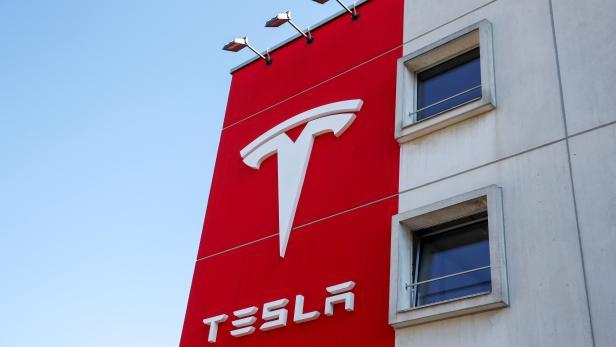 Logo of Tesla is seen at a branch office in Bern