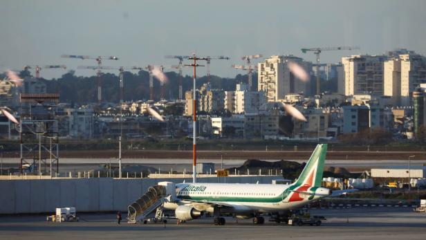 FILE PHOTO: Alitalia plane is seen on the tarmac after landing at Ben Gurion International airport in Lod, near Tel Aviv, Israel