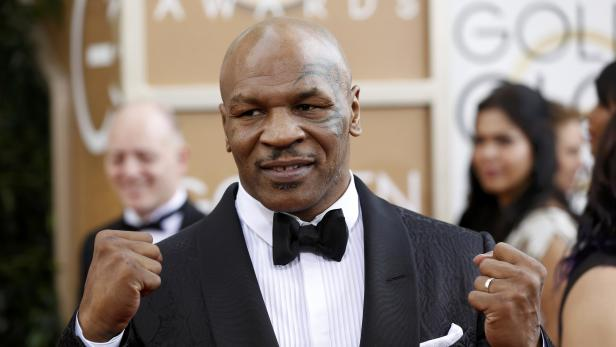 Boxer Mike Tyson arrives at the 71st annual Golden Globe Awards in Beverly Hills
