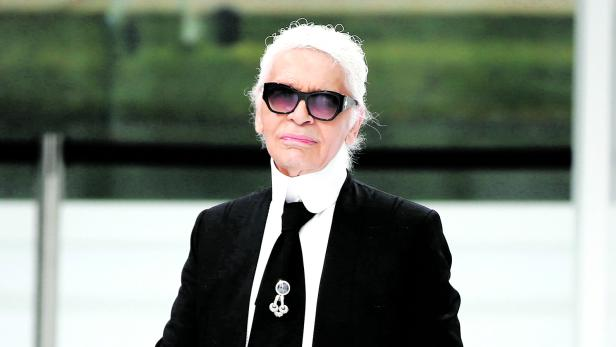 German designer Karl Lagerfeld appears at the end of his Spring/Summer 2016 women's ready-to-wear collection for fashion house Chanel in Paris