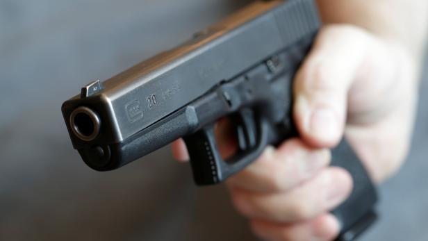 A gun owner displays a Glock 20, 10 mm Auto pistol in Vienna