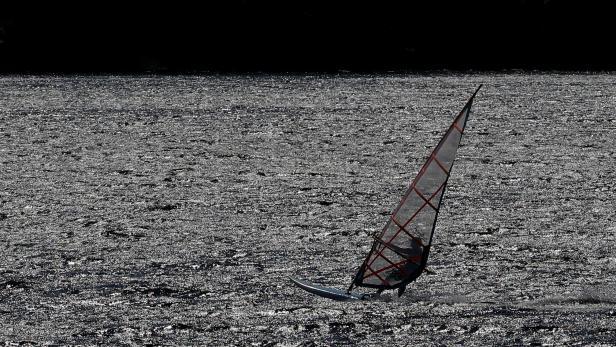 A windsurfer sails on Loch Morlich near Aviemore, Scotland