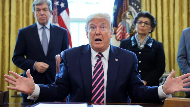 FILE PHOTO: U.S. President Trump participates in coronavirus relief bill signing ceremony at the White House in Washington